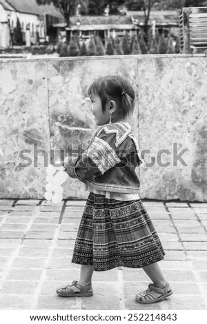 SAPA, VIETNAM - SEP 20, 2014: Unidentified Vietnamese little girl in a traditional clothes . 90% of Vietnamese people belong to the Viet ethnic group
