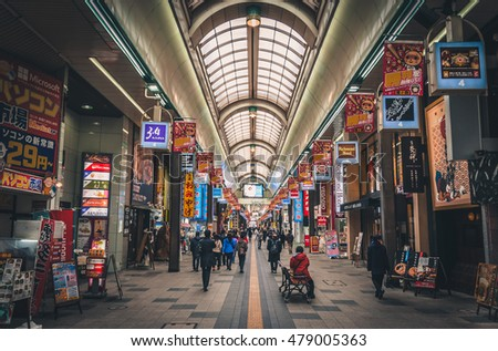 Sapporo, Japan - March 09, 2015: Shoppers walking along the Tanuki-koji shopping arcade filled with shops and restaurants