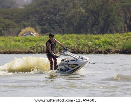 SARABURI THAILAND-JANUARY 20: Sonswut Rappasubpisan in action during show Freestyle the Jet ski  stunt action  on Jan 20, 2013 in SARABURI,Thailand.
