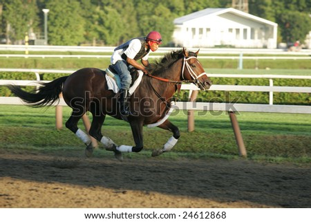 SARATOGA SPRINGS - September 4: A Single Rider in the Morning Workouts at the Saratoga Main Track on September 4, 2005 in Saratoga Springs, NY