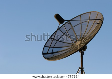 satellite dish - black dish mounted on a rooftop against clear blue sky