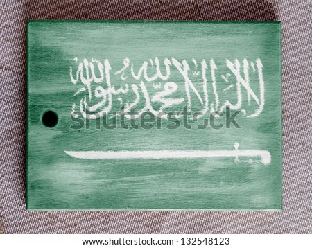 Saudi Arabia flag  painted over wooden board