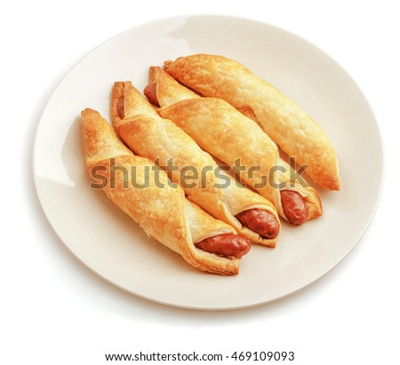 Sausage rolls isolated on white.