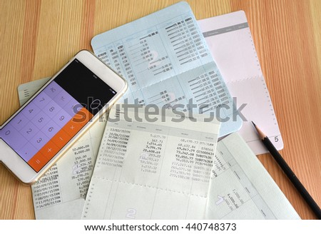 Saving account book from bank with Calculator and pencil for financial and loan