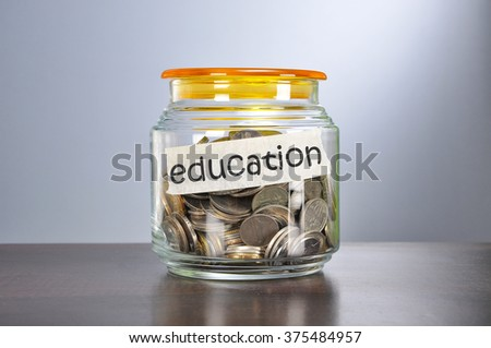 Saving concept of coins in the glass jar for education  purpose.