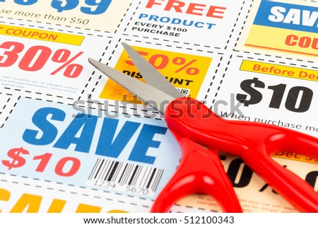 Saving discount coupon voucher with scissors, coupon are mock-up
