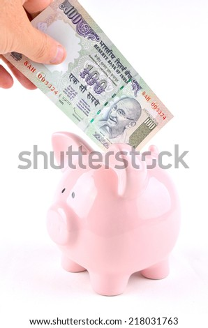 Saving Rupees in a pink piggy bank