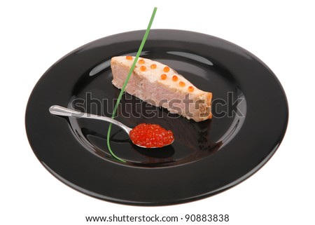 savory sea fish portion : roasted salmon fillet with green onion and red caviar in spoon on black dish isolated over white background