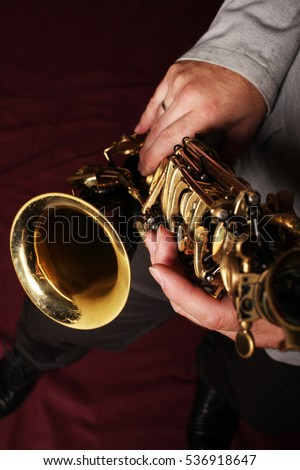 Saxophone in the hands of a musician