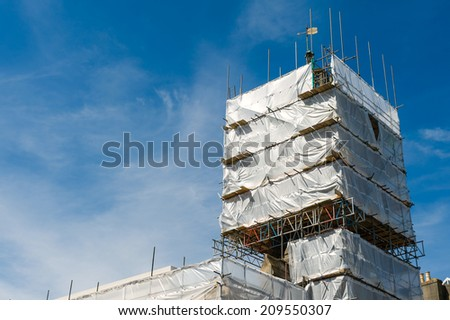 Scaffolding construction with blue sky.