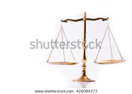 Scales of justice - the symbol of law - isolated, white background