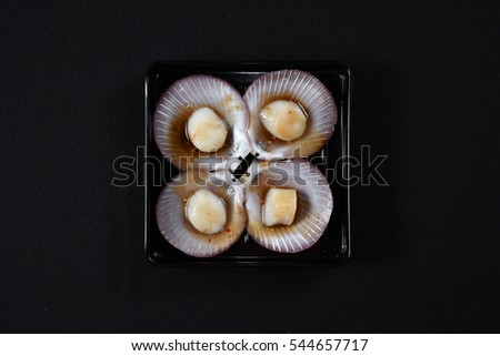Scallop on a black plate