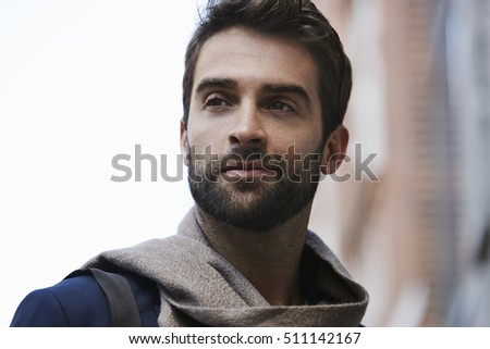 Scarf and stubble man looking away