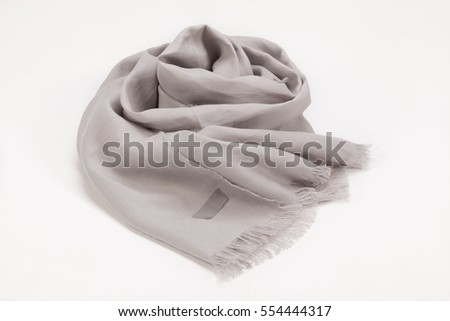Scarf with tassels and  empty tag on white background, scarf top view .