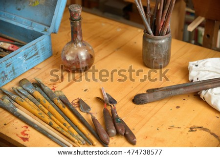 scattered on the table tools of the painter