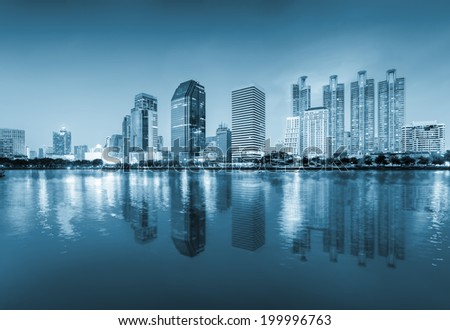 Scenery of bangkok  (blue color tone)  reflect on river.