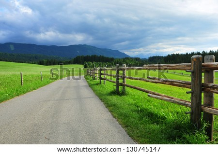 Scenic country road with dramatic clouds