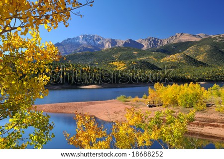 Scenic Crystal Reservoir in the Pike National Forest, of Colorado, during the autumn season with Pikes Peak soaring above