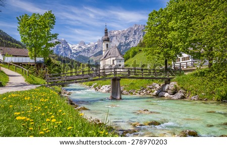 Scenic mountain landscape in the Bavarian Alps with famous Parish Church of St. Sebastian in the village of Ramsau in springtime, Nationalpark Berchtesgadener Land, Upper Bavaria, Germany