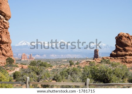 Scenic view of Arches National Park with snowy mountains in the back,  Utah, USA