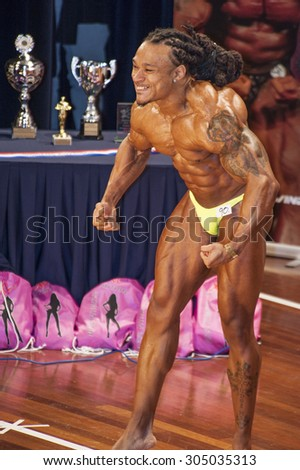 SCHIEDAM, THE NETHERLANDS - APRIL 26, 2015. Male bodybuilders showing their best at the 38th Dutch National Championship Bodybuilding and Fitness of the IFBB Netherlands (NBBF).