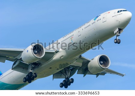 Schiphol, Noord-Holland/Netherlands- October 31-10-2015 -Plane from Garuda Indonesia PK-GIF Boeing 777-300 is started landing at Schiphol Airport. Airplane close-up on a blue sky background.