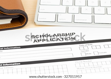 Scholarship Application Form Keyboard Pen Stock Photo