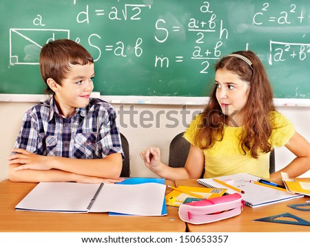 School child with teacher in classroom.