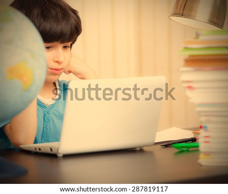 schoolboy doing homework on a laptop. instagram image retro style