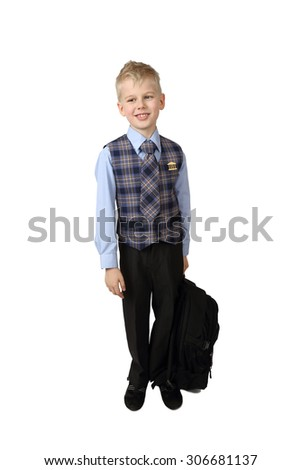Schoolboy in uniform with school backpack in hand stays isolated on white background