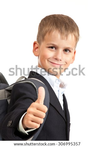 Schoolboy sitting on books isolated on a white background