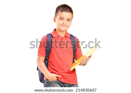 Schoolboy with backpack holding a notebook isolated on white background