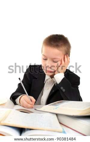schoolboy writing isolated on the white background