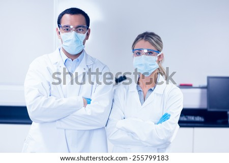 Science students wearing protective masks at the university