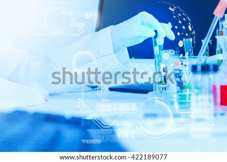 Scientific equipment including a test tube, lamp, microscope, bottle, slide, gloves and other chemicals used for decoration or a science or scientific knowledge, film effect, copy space.