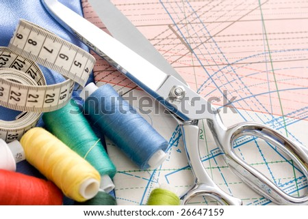 scissors, threads and measuring tape. shallow dof
