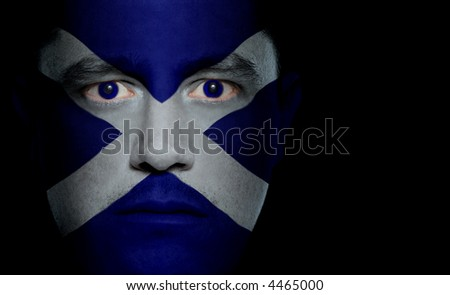 Scottish flag painted/projected onto a man's face.
