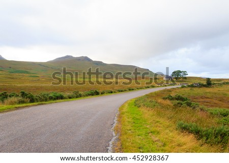 Scottish road trough countryside. Perspective road. Scotland panorama