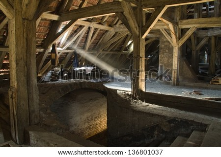scraggly old truss beam of light penetrates to the old land