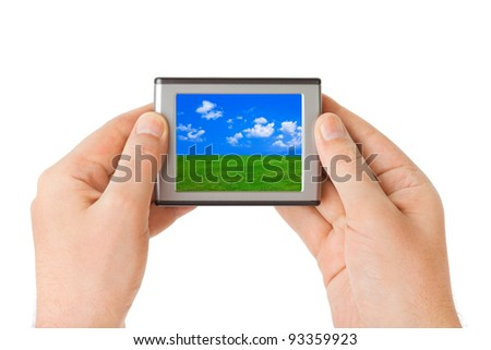 Screen with landscape in hands isolated on white background