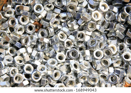 screw nut piled up together, closeup of photo