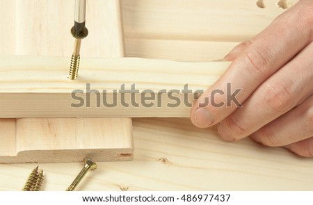Screws on a wooden background.