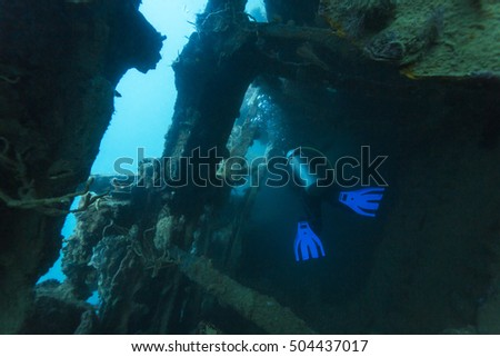 Scuba diver in a ship's wreck