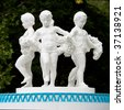 Sculpture in park. Children round dance. - stock photo
