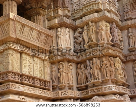 Sculptures of loving couples, illustrating the Kama Sutra, on walls of Varaha Temple,Khajuraho in India, Asia