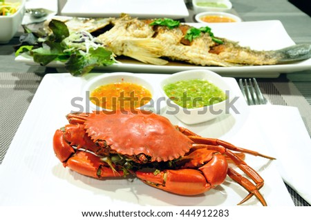 Sea crab and snapper seafood set with spicy sauce
