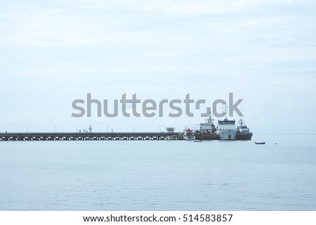 Sea port with boat and blue sky