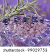Sea-salt and dried lavender on a violet background - stock photo