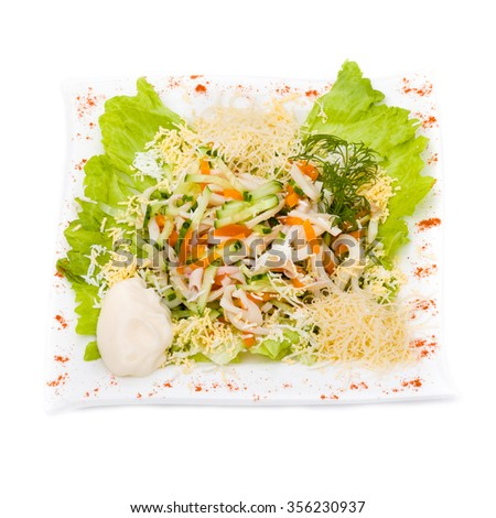 Seafood salad with squid and fresh vegetable, isolated on white background