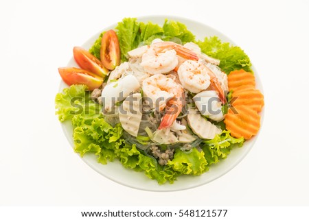 Seafood Spicy noodles salad with thai style in plate isolated on white background